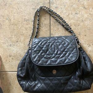 Chanel black caviar quilted handbag